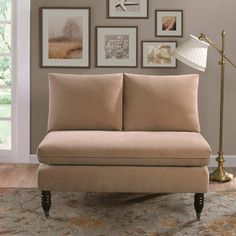 Pillowback sofas for ease of cleaning and a streamlined look, like the one here, is great in a small space.