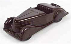 A vintage bakelite Codeg two seater toy car, length 34.5cm.