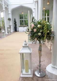 A simple yet very effective way to decorate the Orangery at St Audries Park using the table centre candelabra to line the aisle alongside tall lanterns. The Wilde Bunch Tall Lanterns, Bristol Channel, Table Centers, Park Weddings, Candelabra, Centre, Wedding Flowers, Wedding Venues, Table Decorations
