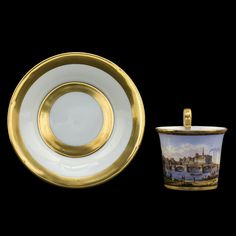 Gilded Meissen tea/coffee cup & saucer, view of Meissen castle.