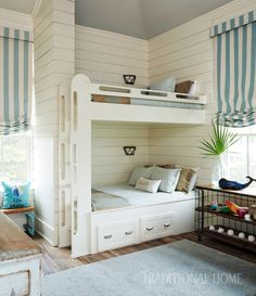 An open and sunny bunk room houses two sets of queen bunk beds. Built-in pullout drawers provide storage space. Cool Bunk Beds, Kids Bunk Beds, Coastal Bedrooms, Coastal Living Rooms, Queen Bunk Beds, Bunk Rooms, Bunk Bed Designs, Kids Bedroom, Bedroom Lamps