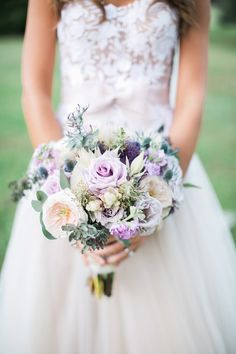 white and purple wedding bouquet with roses