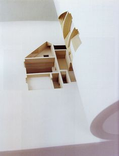 The Negative Space of a House Cut Inside a 908 Page Book sculpture paper home book architecture