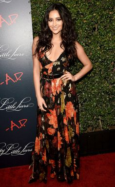 Shay Mitchell is wearing a floral Haney dress with a belt. The dress is fun and lovely! Shay has gorgeous hair!