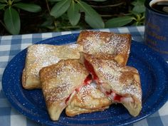 Pie Iron Cherry Cream Cheese Pies.....1 can of Pillsbury Crescent Rolls, 4 Tbsp Cream Cheese, Cherry Pie Filling, Powdered Sugar, & Butter. Unroll the crescent roll dough, take two triangles sections from dough and press the seams together. With your finger tips, press dough out until it about 9 inches long; cut in half at the middle. Place one half in buttered pie iron. Top dough with a couple tablespoons of cherry pie filling and dot with 1 tablespoon of cream cheese. Place other half of…