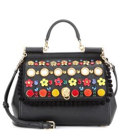 Dolce & Gabbana - Miss Sicily Medium embellished leather shoulder bag - Dolce & Gabbana's covetable 'Miss Sicily' bag is ladylike in its silhouette but playful and rebellious in its embellishment. The classic shape is finished with sparkling crystals, miniature mirrors and bold florals – making a fearlessly stylish statement. For daytime, carry it next to pretty sun dresses or casual denim, swapping to a structured LBD come cocktail hour. seen @ www.mytheresa.com