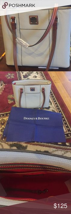 Dooney and Bourke New New with tags Dooney & Bourke tan bag with Red inside. Dooney & Bourke Bags Shoulder Bags