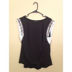 Black bebe top A very cute simple but very stylish black and white top with embellished sleeves bebe Tops