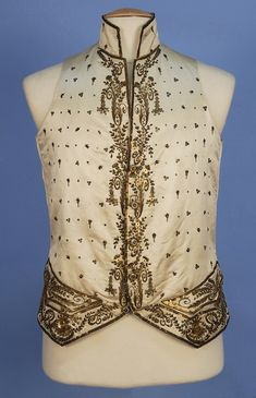 GENT'S METALLIC EMBROIDERED WAISTCOAT, 18th C. Cream silk satin with stand collar and pocket flaps over faux buttons, decorated with gold thread and sequins, satin back with ties, satin lining. Ch-40, L-26. Excellent. $300-400. http://whitakerauction.smugmug.com/Fall2013-5/Clothing