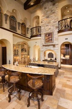 Nice kitchen.   Love the stone and cabinets....who wants a balcony in your kitchen?    Yes. Please.