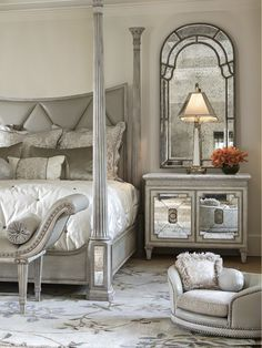 The diamond tufted upholstered Ionia bed with iconic tapered and fluted Greek columns: true glam!