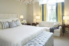 Master Bedroom | Blue & White Striped Bed Bench | Blue & White Striped Pillows | White Headboard | White Bedding | Yellow Accent Window Drapes