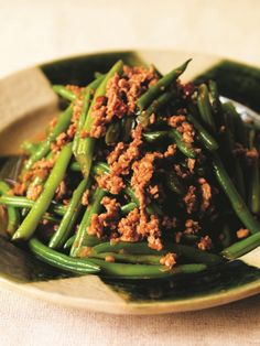 Harumi Kurihara's recipe for Green Beans With Minced Pork, a delicious Japanese dish that is perfect for a weekday meal. A little meat goes a long way, used almost like a warm dressing for the beans, a great way to reduce one's meat intake.