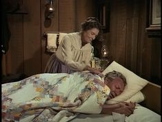 Little House on the Prairie, Season 1, Episode 24: Mr. Jim Tyler is being lovingly tucked into this Irish Chain quilt by his wife. This sure looks a lot like the quilt we saw Mrs. Harriet Oleson under in episode 19 of Season 1. Hmmm...