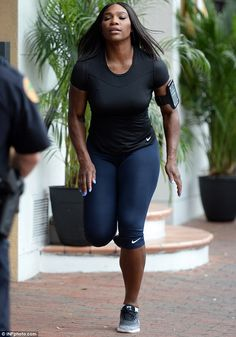 Honed and toned: Serena Williams showcased her super fit body as she worked up a sweat during a run in Coral Gables, Florida on Monday