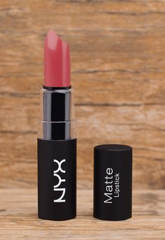 "This NYX Matte Lipstick in ""Audrey"" is highly pigmented, richly formulated and long-wearing. The velvety, non-glossy, high-fashion formula glides on smoothly and envelops lips in a non-drying, matte f"