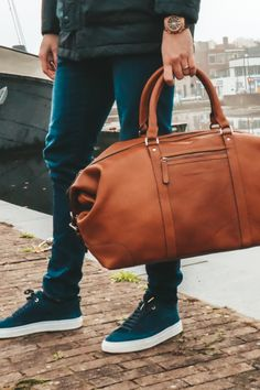 Meet your new best friend CALEB! This leather weekend bag features a spacious main compartment (over 37 litres) with a reinforced laptop and tablet compartment. 💻 Currently available in the colours cognac and black. #TheChesterfieldBrand #chesterfieldbags #mychesterfieldbag #leather #weekender #holiday #weekendtas #handmade #lerentas #brand #brandspirit #autumn #success #nature #Urban #coffee #coffeelover #start #positief #ootd #motivationalquote #honouryoursuccess #positivity #fall #Cale Weekend Bags, The Ch, Chesterfield, Autumn, Fall, Weekender, Brand You, Leather Bag, Messenger Bag