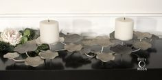 Uttermost Lying Lotus Metal Candleholders. Candleholder is made of hand forged metal finished in champagne silver and pewter. This may be hung on wall or used on tabletop. Two white candles included.