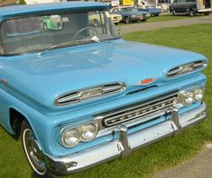 vintage blue chevrolet truck   Looks like a '61 one of the frog eyes years.