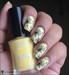UberChic Beauty Collection 2-02. I absolutely love this nail art! Chevron designs are my favorite. I love this yellow and black manicure with stamped designs from UberChic. I have to try this design for myself! I love nail art!