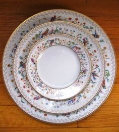 A dinner plate, a salad plate and a bread and butter plate in Tiffany & Co.'s Audubon pattern.