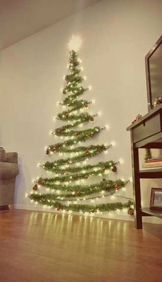 Easy Christmas Decor From simple to amazing Notable tips and tricks to form a fun and charming simple christmas decor diy xmas trees . Xmas image provided on this day 20190114 , exciting post reference 3707337813 Wall Christmas Tree, Noel Christmas, Diy Christmas Wall Decor, Xmas Trees, Tinsel Tree, Outdoor Christmas, Homemade Christmas, Christmas Projects, Christmas Tree Made Of Lights