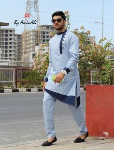 Mens Designer festive cotton pathani suit with collar neck, short button placket and full sleeves and curve hem. Comes with matching bottom.