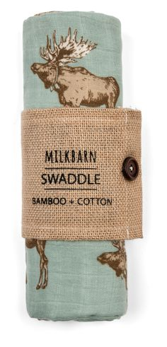 "Incredibly soft! Made with 70% rayon from bamboo and 30% cotton. Packaged in a burlap sleeve with wooden button. Blanket measures 47"" x 47"". Imported. By MilkBarn Kids (formerly Zebi Baby)."