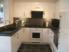 White Cabinets Grey Tiles Black Worktop Too Shiny