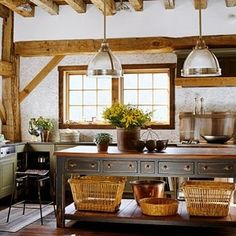 Baskets add country cottage charm, and storage, to an island. by daisy