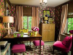 The wallpaper was what inspired the makeover of this mere 12- by 13-foot room. The rich colors and large-scale pattern actually make the room feel more expansive while remaining intimate. The floor was painted, and even more pattern was brought into the room in the hooked rug and the striped silk curtains. Footstools were reupholstered in pink so they blend with the rest of the decor.   - ELLEDecor.com