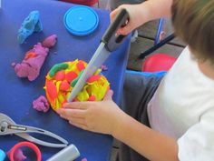playdough with play tools (plastic screwdrivers, saws etc)  raid the dollar stores for supplies!!  I have always had tools in play dough area...Head Start taught me well!