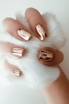 CHROME NAILS  The future is now, and we've already fallen hard for high-shine metallic nail finishes. Go for rose gold if you're feeling adventurous.