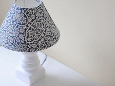 Over the years I've gotten into the habit of re-covering my existing lampshades rather than buying new ones entirely. This DIY lampshade cover tutorial is a nice way to match my seasonal decor perfectly (fabric choices seem to be way more abundant than pre-existing lampshades anyway).