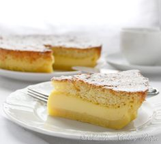 Magic cake. The magic is in the fact that you make only one batter and, after baking, you get a cake with 3 distinct layers: dense one on the bottom, custard-like layer in the middle, and a sponge layer on top.