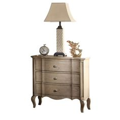 This Anatolio 3 Drawer Nightstand in antique taupe finish features 3 convenient drawers. All drawers have side metal glides with full extension. The nightstand is complemented by felt-lined top drawer and wooden cabriole legs.