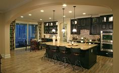 Cool archway, lots and lots of small lights, light and dark contrast, double oven, bar seating, and breakfast nook.