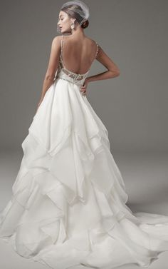 Glamorous beaded scoop back ballgown wedding dress with layered skirt; Featured Dress: Maggie Sottero