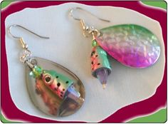 http://diginanchors.com/EarringsAlure_BeardedTarpon - Handmade dangling earrings with beautiful pink,green,and silver colored blade and a fish body added along with a clear crystal.Has surgical stainless steel earwires coated with gold or silver plating.The unique earrings are 2 and 1/4 inches long and 1 inch wide.