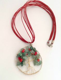 The tree of life wire wrapped pendant with agate gems on red strings