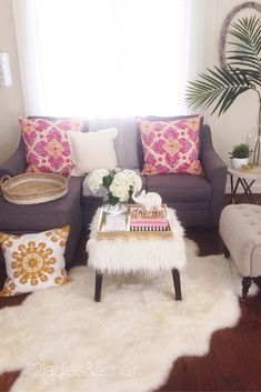 We 2 Ladies always recommend choosing neutral color fabrics for big ticket furniture. Color fads come and go, but your big furniture pieces should last many years. You can still have fun with trendy colors with throws and pillows. All the furniture pieces here are from HomeGoods. Grey, white, and tan are fabulous neutral colors that are easy to accent with many different colors. Sponsored by HomeGoods