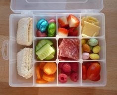 My little boys lunchbox for pre-school - in a craft box.  It's easy to get at all the snacks which are in just the right quantities, and none of them touch each other!  Looks yummy doesn't it?  He loves it and likes to take it everywhere.  We get lots of comments when we are out and about.