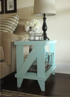 "All surfaces are sanded smooth and is constructed very sturdy. Table is clear coated with polyurethane. Can used for indoors or out side. End table dimensions are 27.5"" inches long, 15.5 inches wide, 23 inches tall. This particular color is Ocean Mist blue, but I can create this table to your specifications and choice if paint/stain color. I do all sorts of custom wood work from ideas from Pinterest and Etsy. Any questions, please feel free to call/text or email me, Daniel at 910.381.8551…"