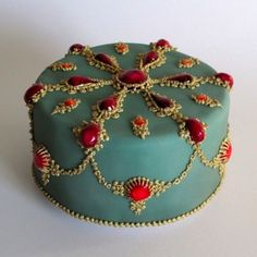 Bejeweled cake for Christmas - rich fruit and nut cake filled and coated with marzipan, fondant iced with glazed fondant 'jewels' and piping painted with gold edible lustre