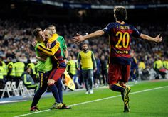 Andres Iniesta of FC Barcelona celebrates with Lionel Messi after scoring his team's 3rd goal during the La Liga match between Real Madrid and Barcelona at Estadio Santiago Bernabeu on November 21, 2015 in Madrid, Spain.
