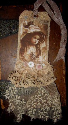 Vintage Lace Collage Spring Hat Girl Sepia Embellished Tag. $16.99, via Etsy.