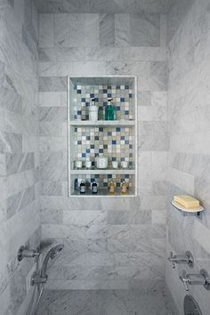 Artistic Tile    Detail This shower features Bianco Carrara field tile with a custom inset of our Hamptons Blend -  Westhampton glass and stone combination