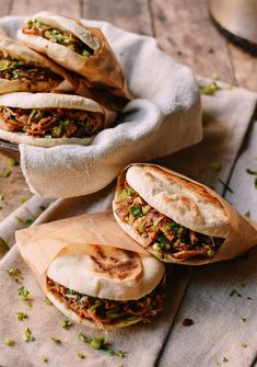 """Chinese Hamburger, Rou Jia Mo (肉夹馍) means """"meat in a bun,"""" which sort of makes it similar to what we'd think of as a hamburger, or maybe a Chinese sloppy joe. So there's the meat filling of shredded pork belly with spices and fresh herbs sandwiched between a homemade pan baked bun."""