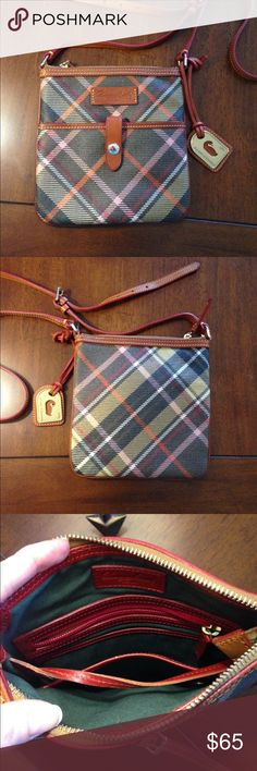 Dooney and Bourke Crossbody Letter Carrier Bag Adorable pink, orange, red, black, white and tan plaid Dooney and Bourke letter carrier bag.  Purchased brand new and used once. It has been in a purse bag the entire time I've owned it. Dooney & Bourke Bags Crossbody Bags