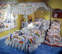 Canopy beds...I had one! Mine was all pink dotted Swiss. I had rainbow everything else, though!